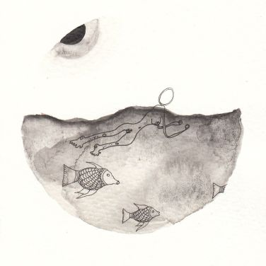 Numme qui nage dans la mer avec des poissons